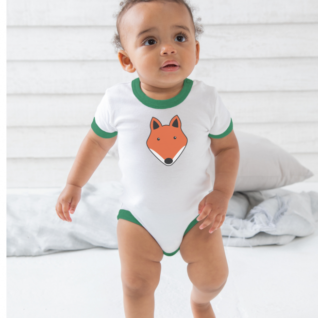 baby walking wearing a tommy and lottie organic cotton fox baby body suit with green edging
